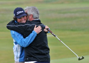 Cormac Sharvin (Ardglass) celebrates with his caddy Brian Martin after holing his birdie putt on the 18th green to win the AIG sponsored Irish Amateur Close Championship at Connemara Golf Club  Picture by Pat Cashman