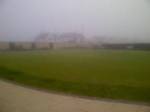 Sea mist envelopes the putting green at Royal Portrush