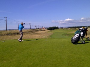 Driving off the 13th tee at Dundonald Links