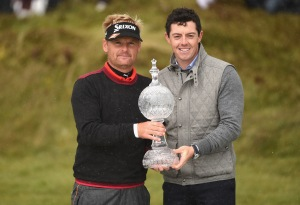 Soren Kjeldsen of Denmark receives the Irish Open Trophy from Rory McIlroy