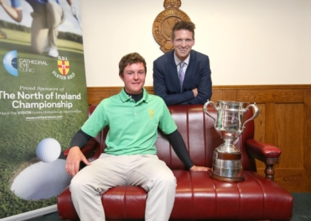 Andrew Spence, Principal Optometrist at Cathedral Eye Clinic, presents the trophy to Whitehead's John Ross Galbraith, winner of the North of Ireland Amateur Open Championship 2015