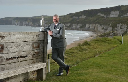 Ryder Cup captain and former Open winner Darren Clarke stands with the claret jug on the 6th tee at Royal Portrush Golf Club overlooking the White Rocks