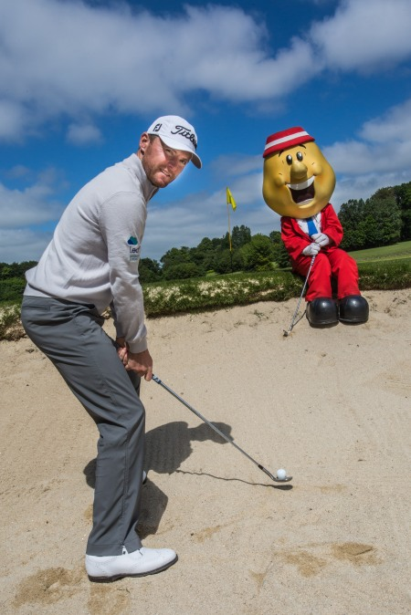 Mr Tayto keeps an eye on Tournament Ambassador Michael Hoey's bunker play' (Photo: Ewan Harkness)
